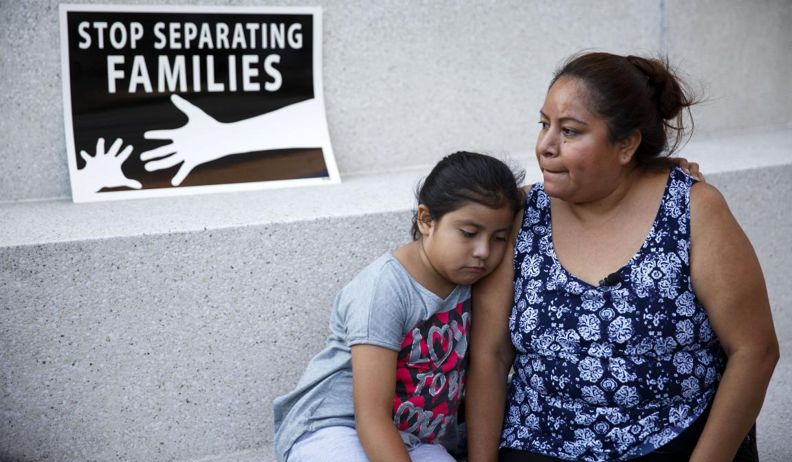 A mother and daughter in Los Angeles react after the U.S. Supreme Court issued a split ruling June 23 blocking President Barack Obama's executive actions to temporarily stop deportations. (CNS photo/Eugene Garcia, EPA)