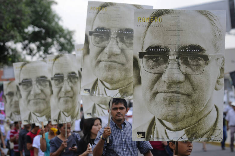 People carry large portraits of Salvadoran Archbishop Oscar Romero during rally in his honor in San Salvador (CNS photo/Roberto Escobar, EPA)