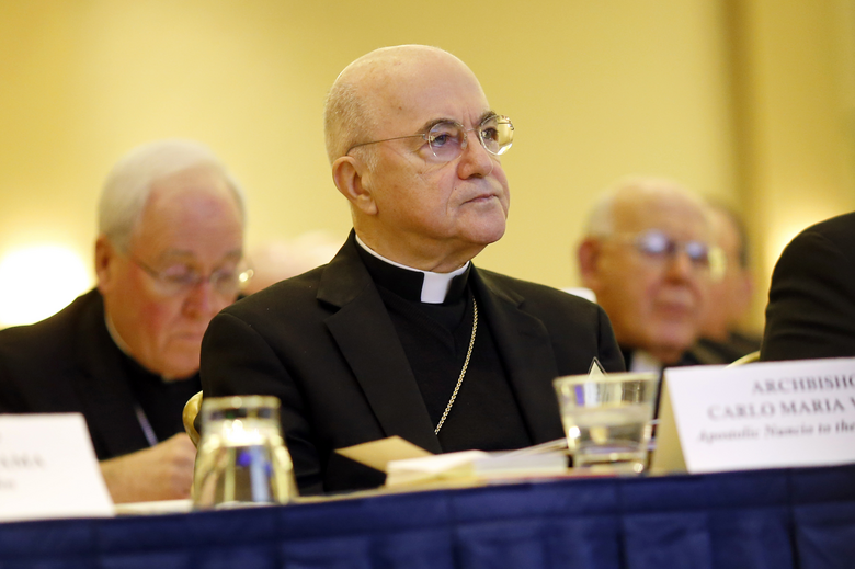 In this Nov. 16, 2015 file photo, Archbishop Carlo Maria Vigano, Apostolic Nuncio to the U.S., listens to remarks at the U.S. Conference of Catholic Bishops' annual fall meeting in Baltimore. (AP Photo/Patrick Semansky, File)